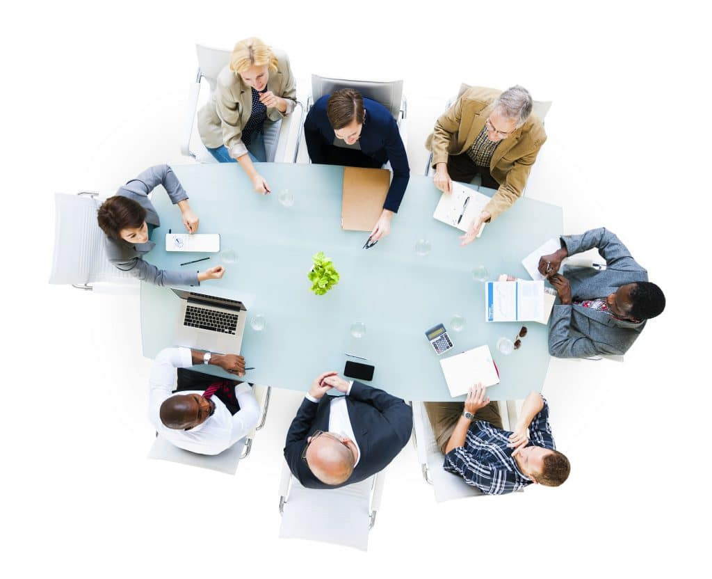 Group Of Business People Around The Conference Table Having A M