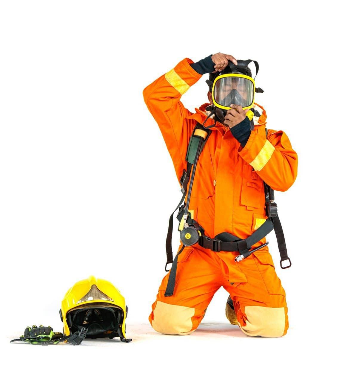 Firefighter In Uniform And Safety Helmet Standing Full Body Leng
